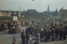 THE LIBERATION OF EINDHOVEN, HOLLAND, 20 SEPTEMBER 1944. Dutch civilians jump on the bonnet of a jeep in Eindhoven, as crowds cheerleader the British Army as it passes through. Pin by Paolo Marzioli