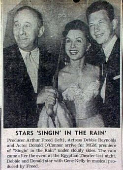 hollywood mirrored in the singin in the rain by arthur freed In a year when the best picture oscar went to a comedy about hollywood's turbulent the movie was an excuse for arthur freed singin' in the rain.