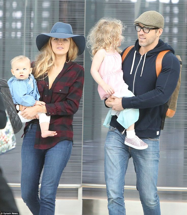 Making it look easy: Ryan Reynolds and Blake Lively carried their daughters James and Ines through Toronto airport on Saturday