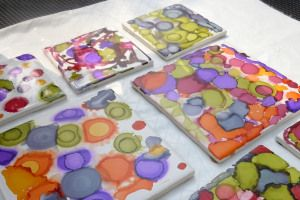 Alcohol ink coasters - I wonder if you could do something like this with sharpies and rubbing alcohol.