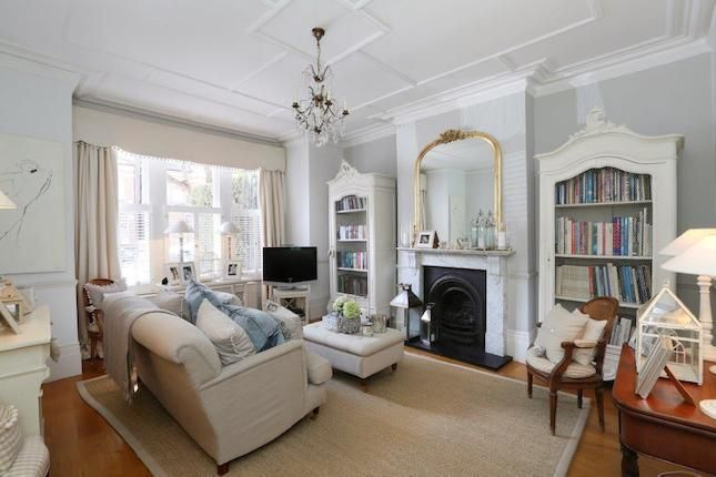 Nice mirror above fireplace.  Also large cost rug in light colour to contrast against the natural wood floor