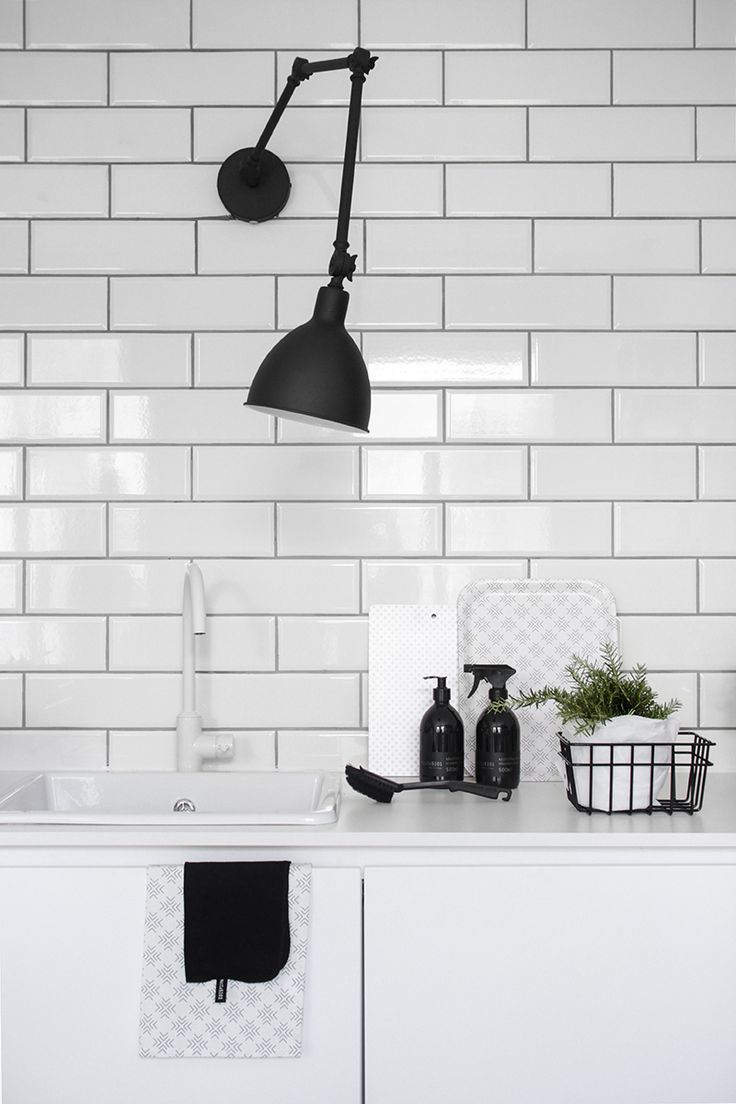 Best 25 black wall lights ideas on pinterest asian wall scandinavische keuken in zwart wit thema met witte tegelmuur en mat zwarte industrile lamp amipublicfo Image collections
