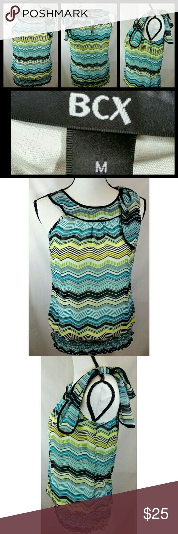 BCX Multicolored Chevron Dress Top Brand: BCX Multicolored Chevron Dress Top  Type of Garment: Women's Dress Top  Specifics: Lined, scoop neck, bow across left shoulder, sleeveless, 3 button back collar, chevron design, 3 inch elastic band at waist Material: 100% polyester Color: Black, blue, green, yellow white  Size: Medium  Condition: Pre-owned, EUC. Smoke freeenvironment. Measurements: Pit-to-pit: 17 inches Length (Bottom of Collar to Hem): 23 inches Sleeves (Top of Shoulder Seam to…