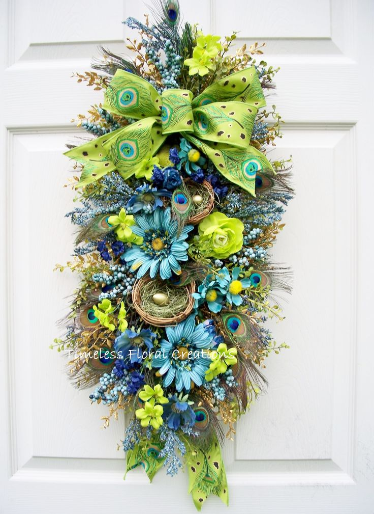 Peacock swag http://www.timelessfloralcreations.com/ https://www.facebook.com/timelesswreaths