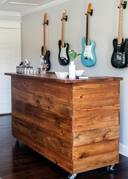 The music room includes this bar on casters, custom made by furniture builder Clint Harp and covered in shiplap that had been planed down and refinished.