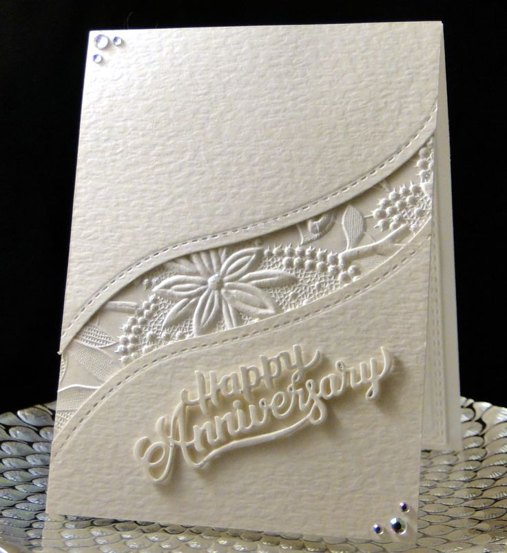 P&H Anniversary 2017 Hammered card stock. embossed dp. Happy Anniversary cut 3x's and stacked. Stickles on the round parts of the embossing including the center of the flower. Brilliants matched the Stickles. Designed and created by Peggy