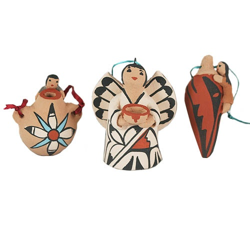 Pueblo-Style Ornaments - These ornaments are handmade by artists from the Jemez Pueblo, which is one of the 19 pueblos located in New Mexico. Jemez is known for the beautiful red clay used for pottery, and its people are known internationally for their beautiful arts and crafts.  Choose from the following: Water Jug, Chile Pepper, Angel, or Koshare (sacred Pueblo clown). Handmade, so each piece is somewhat unique and may not exactly resemble the image shown. Initialed by the artist.