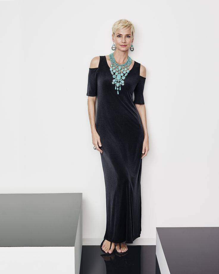Give winter the cold shoulder with this maxi-dress. Elevate the look with a punch of turquoise.