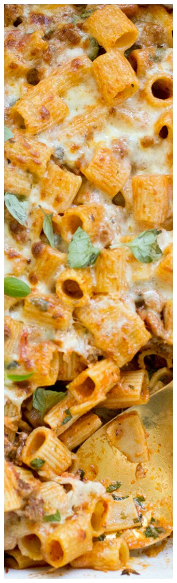 Creamy Baked Sausage Rigatoni ~ The ultimate in weeknight comfort food... Small Mezzi Rigatoni noodles in a rich and cheesy pink sauce, baked to perfection.
