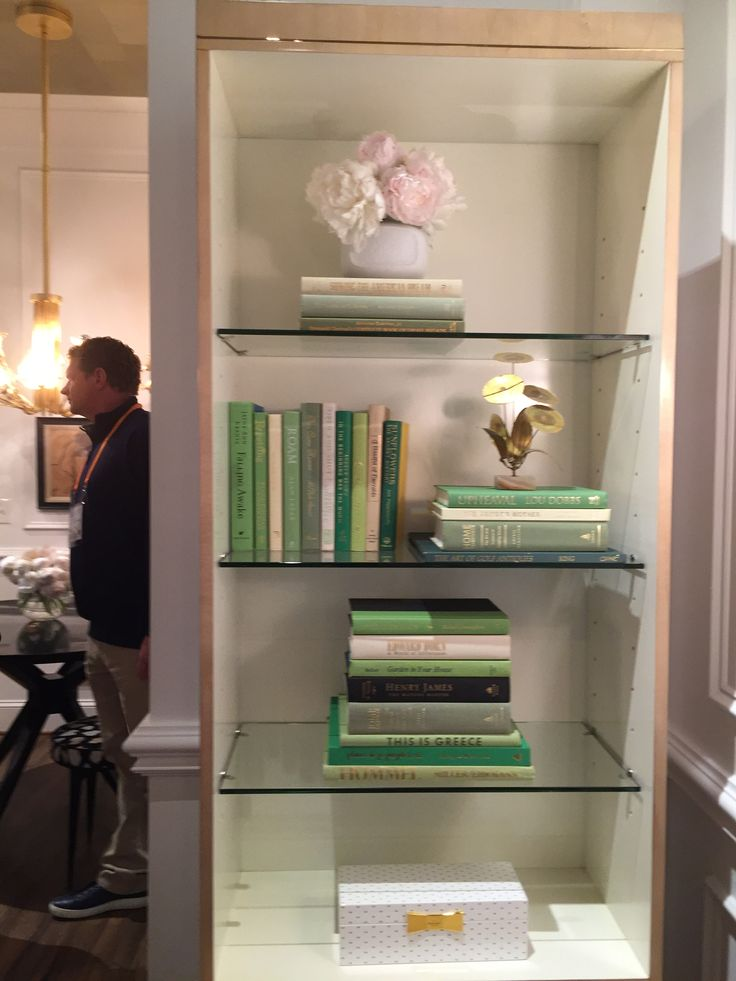 Kate Spade ... Knows how to style a bookcase ... Where do you get all green books ?