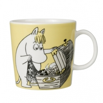 Moomin Snorkmaiden.  I broke mine years ago and still mourn its loss.  On one side she is looking through her treasures, on the other side she is relaxing in a field of flowers. Two wonderful activities! Oh how I miss her!