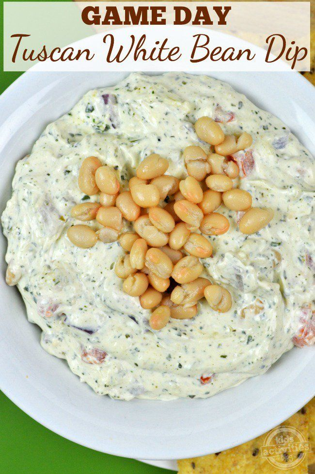 This delicious Game Day Tuscan White Bean Dip recipe is perfect for pleasing a hungry crowd!