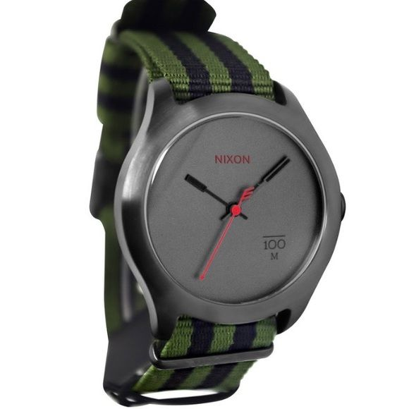SUPER SALEMens Nixon Watch Brand New Mens Nixon watch, with original box stickers and tag. Make an offer.    Brand:	Nixon Band Color:	Green and Black Band Material:	Nylon Band Width (MM):	20 Case Diameter (MM):	39 Clasp:	Buckle Crystal:	Mineral Watch Movement:	Quartz Water Resistance (M):	100 Nixon Accessories Watches