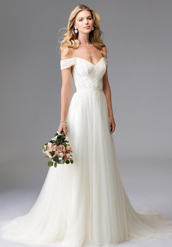 Heaton is perfect marriage of modern edge and classic romance. This gown features an off-the shoulder, Lingerie Lace corset bodice with a Soft Net, A-Line skirt, adding a touch of dainty elegance. The Grosgrain Ribbon waistband adds definition to the waist. Sweep Train.