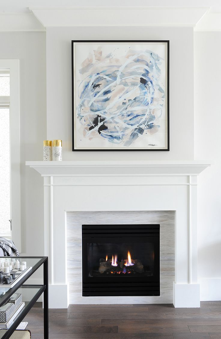 A Bold And Beautiful Art Piece Above A Fireplace