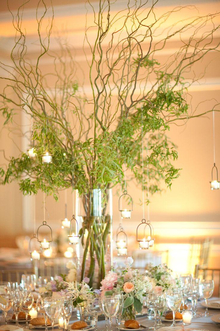 Vine centerpieces with hanging votive candles