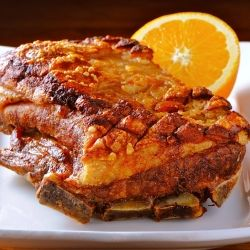 Crispy Skin Bone-in Pork Belly with Citrus Caramel Vinegar Glaze by Bill Granger.