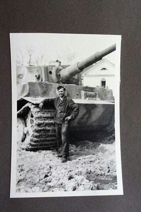 A personal photo showing a crewman posing with his Tiger 1