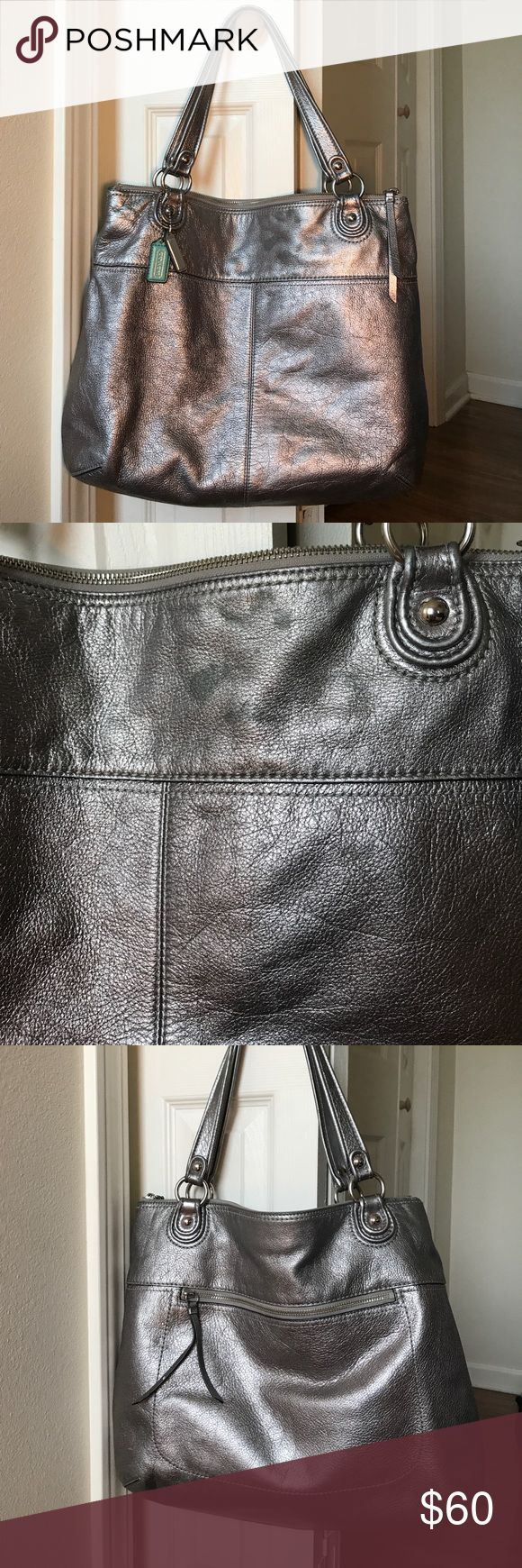 Coach metallic shoulder bag Best purse ever and I wore the heck out of it to be honest. I pulled the linings out to show all the stains and wear. The outside still looks pretty darn good! The wear doesn't show too bad I think because of the color and the way the the leather wrinkles naturally. Some spots in front top, see pics for all signs of wear! Open to reasonable offers. Coach Bags Shoulder Bags
