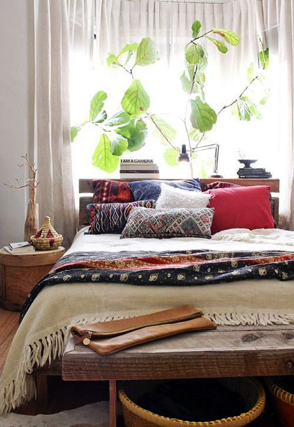 Relaxed boho bedroom with tribal textures and kantha quilt (via Decorator's Notebook blog).
