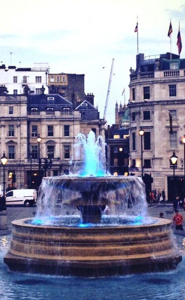 The fountains of Trafalgar Square, lit in blue lights to celebrate the wee 8 pound, 6 ounce bundle of joy, Prince George.
