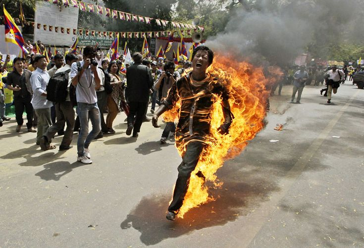 A Tibetan man screams as he runs engulfed in flames after self-immolating at a protest in New Delhi, India, ahead of Chinese President Hu Jintao's visit to the country, on March 26, 2012. The Tibetan activist lit himself on fire at the gathering and was rushed to hospital with unknown injuries, reports said.