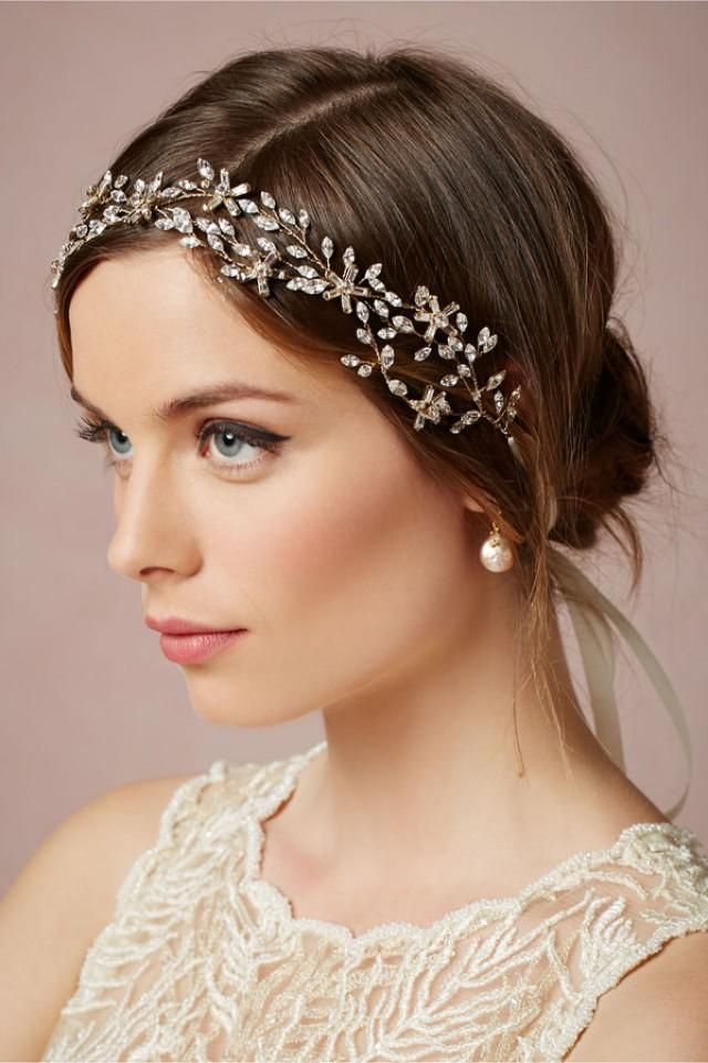 "Navette crystal leaves and baguette flowers are entwined with wire into an elegant, organic creation fit for the bride's tresses. Loops on each end allow for the piece to be placed as desired and secured with ribbons or ties. From Untamed Petals. 19""L, 0.5""W ties"