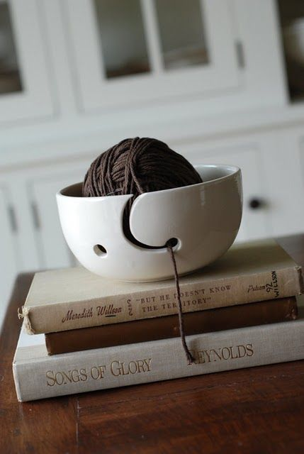 Knitting yarn bowl. Even if you don't use it for knitting, makes a nice piece for decoration.