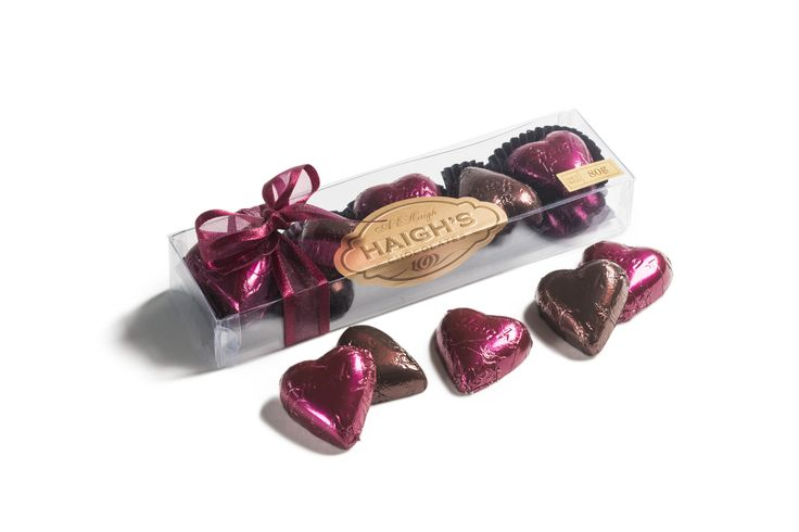 6 burgundy foiled milk chocolate and 4 bronze foiled dark chocolate hearts in a clear gift box.