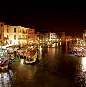 View of the Grand Canal at night from the Rialto Bridge.