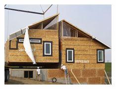Modular Home Being Craned Onto A Bat