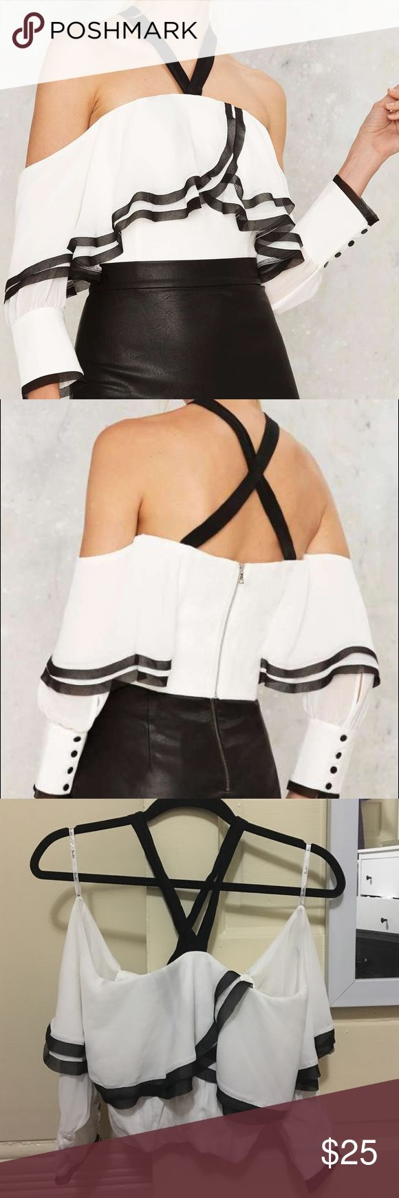 Nasty Gal Matador Off-The-Shoulder Top Size Small/6. The Matador Top features ruffly white details with black mesh trim, and shoulder straps that create a v at the neckline. The cuffs close wuth four black buttons and the back zips closed with a silver zipper. Polyester. Model is wearing a size S. Bardot Tops Blouses