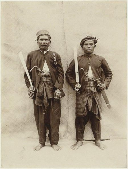 Indonesian Atceh warriors 1897 with there daggers and Rencong(the traditional long daggers used in Aceh, these are the L shaped hilts that can be seen sticking out of their cummerbunds).