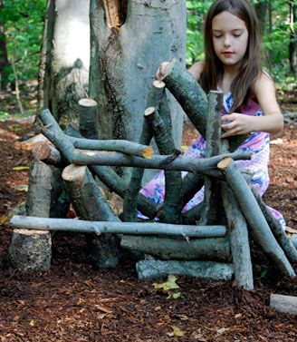 Building with logs is a way for children to learn about balance, weight, lengths and to use their imagination.