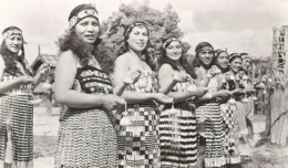 Young Maori women performing a Poi dance. The histpry of Poi