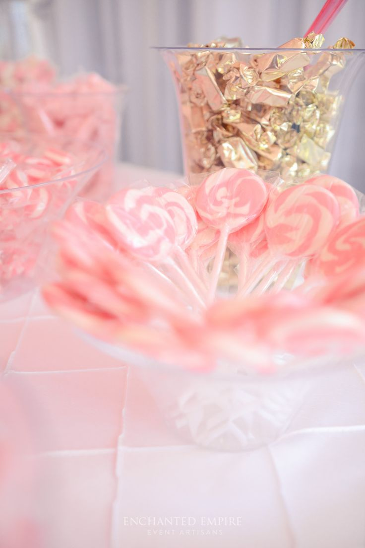 The romantic combination of peony pink and champagne gold were the perfect colour combination for this wedding candy bar. Varying hues of pink were placed down the table, throughout the delicious candy choices and golden wrapped toffees. Custom designed chocolate wraps complimented and personalised this delicious candy bar. To complete this candy bar, gold tasseled pink Geronimo Balloons added a fun and inviting statement.Youtube: https://www.youtube.com/watch?v=BbGSdXJDllM&feature=youtu.be