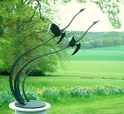 'garden sculpture of flying birds' (fantastic sculpture and photograph of sculpture!)