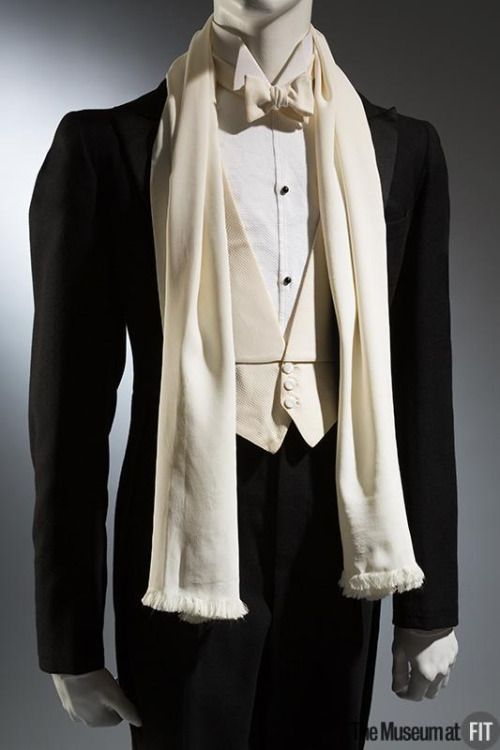 Go all out in a tuxedo with white waistcoat and white scarf