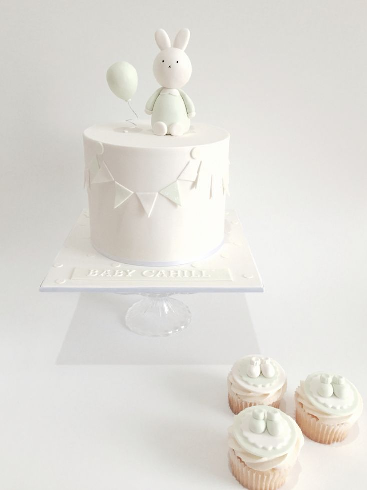 Bunny baby shower cake with bootie cupcakes. By Jenelle's Custom Cakes!