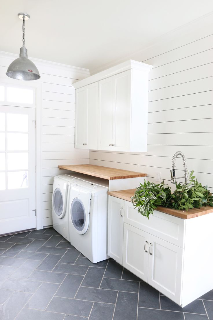 Laundry room with shiplap walls and herringbone