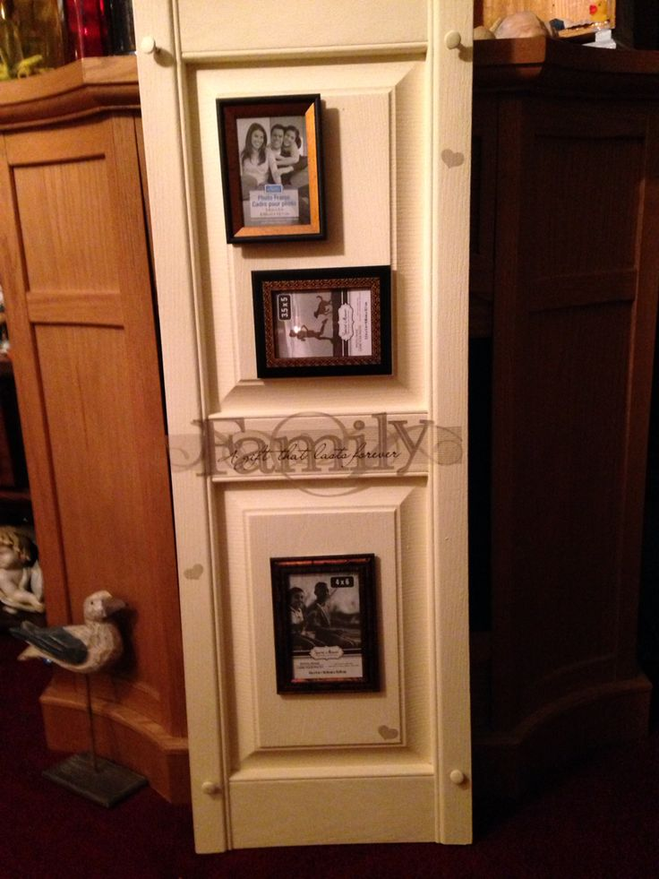 Made with a plastic shutter. The picture frames are held on with command Velcro so pictures can be changed or rearranged. Left the screws so it could be hung on the wall.