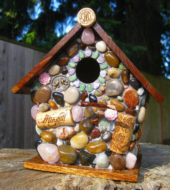 mosaic birdhouse from found objects