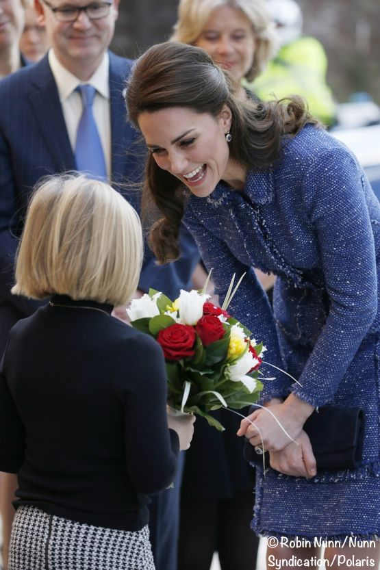 Kate-Ronald-McDonald-Blue-Rebecca-Taylor-sparkle-Tweed-New-Getting-Flowers-from-Isabel-Feb-28-2017-R-Nunn-Synd-Pol-555-x-833.jpg