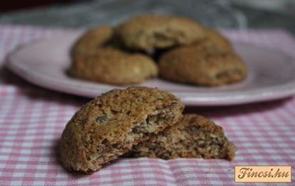 Bögrés zabpelyhes - csokis keksz  Hozzávalók - 2 bögre őrölt zabpehely - 1,5 bögre kókuszreszelék - 2 bögre liszt - 1 bögre cukor - 2 bögre darált dió - 2 tábla étcsoki (kisebb darabokra törve) - 3 egész tojás - 35 dkg puha vaj - 1 tk. só - 1 tk vanília aroma - 1,5 tk. szódabikarbóna - 1 tk. őrölt fahéj
