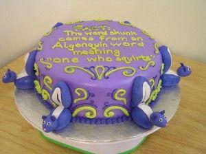 I love the little fondant skunks on this cake :)