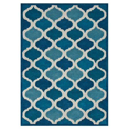 Handcrafted wool rug with a quatrefoil motif.     Product: RugConstruction Material: 100% WoolColor: ...