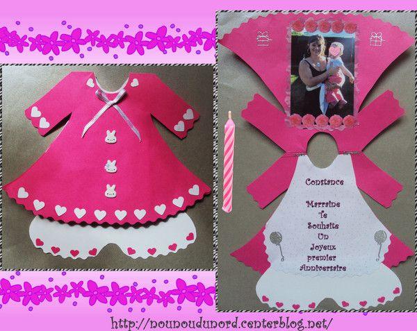 Pour l'anniversaire des 1 an de ma filleule Constance j'ai réalisé une carte en forme de robe robe en rose fushia