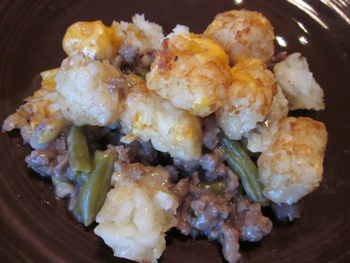 Tater Tot Hotdish: 1 lb browned beef, can cream mushroom soup, 1/2 c milk, can green beans, tater tots
