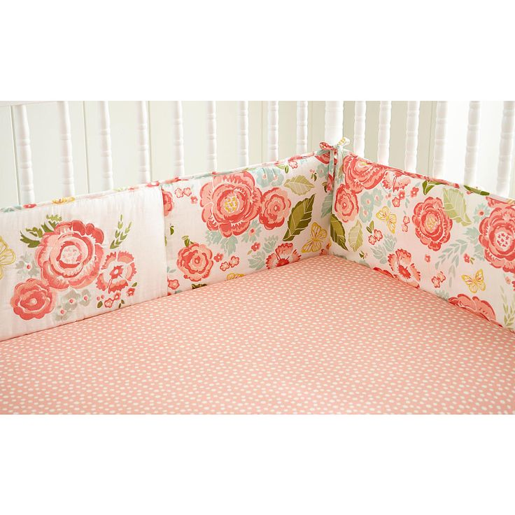 The Charlotte Crib Bumper is a four piece bumper featuring a beautiful cream, coral and aqua floral print on the front and back with a flower embroidery in the center. Coordinates with the Charlotte Nursery Bedding Collection.