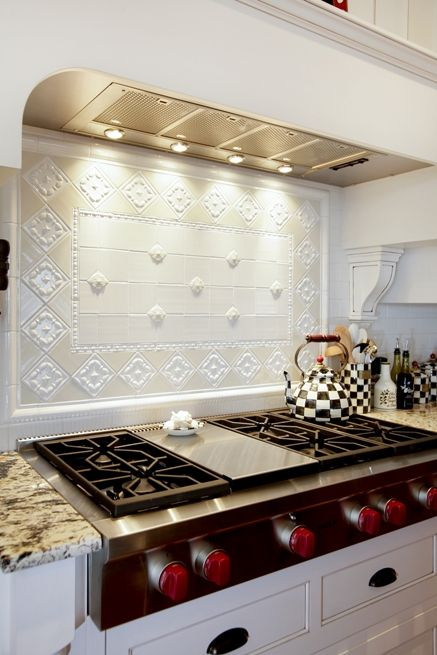 Love the red knobs on the Wolf gas cooktop. Home built by Martin Bros. Contracting, Inc.